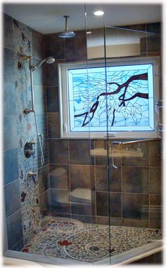 """I love the shower floor (minus the leaves) - """"The God Spiral"""" - Tiles with Style, a decorative ceramic tile studio specializing in custom hand made tiles,..."""