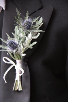 This thistle & senecio boutonniere is a great modern take on an old tradition. http://www.houseofflowersonline.com/