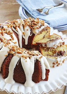 A recipe for cinnamon roll Bundt cake, featuring yellow cake with pecan streusel and a cream cheese glaze.