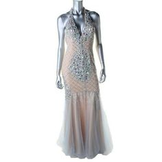 TERANI COUTURE Tan Embellished Halter Full-Length Manufacturer:?Terani CoutureSize:?4Size Origin:?USManufacturer Color:?Nude/BlueRetail:?$349.0 Condition:?New Style Type:?Formal DressCollection:?Glamour By Terani CoutureSilhouette:?MermaidSleeve Length:?SleevelessClosure:?Hidden Back ZipperDress Length:?Full-LengthTotal Length:?63 Inches Bust Across:?Inches Waist Across:?15 1/2 Inches Hips Across:?18 1/2 Inches Material:?100% PolyesterFabric Type:?MeshSpecialty:?Padded Bust Terani Couture…