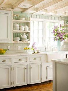 White on white kitchen, pale green beadboard, drawer cup pulls, cabinet knobs, white subway backsplash, neutral island