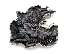Ying Hsun Hsu Brooch: In Flux, 2014 Magnetized iron flakes, resin, black gold plated, white gold plated