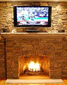 real stone fireplace pictures | Standout Manufactured Stone Fireplaces! Stone Fireplace Designs Guide