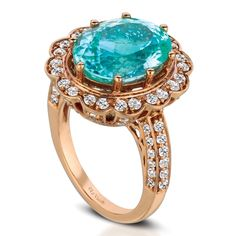 An oval-shaped paraiba tourmaline sits at the center of an 18k Strawberry Gold setting surrounded by 1.50 cts. t.w. Vanilla and Chocolate Diamonds in this lively ring from Le Vian Couture.    Le Vian Couture