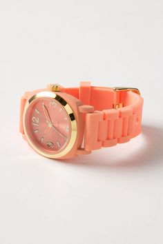 Rose colored watch. I am not a girl wearing pink and rose. But I like the idea of gold with a nice color.