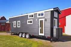 A two loft, 310 square feet tiny house on wheels in Delta, British Columbia, Canada. Built by Tiny Living Homes.