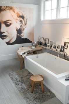Bathroom dreams & beyond - Natural light, soaker tub romance, Marilyn portrait, natural wood textures, metal shelved collage with simple nuetral decor via interior design