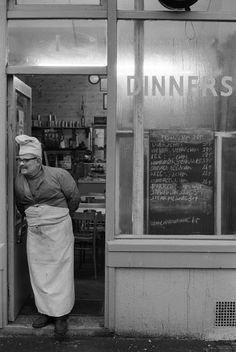Brick Lane cafe owner, East London, England by Homer Sykes, 1974 Look at the prices!