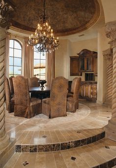 Mediterranean Formal dining in the round with dome ceiling...