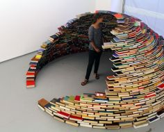 Miler Lagos, a Colombia-based artist, carefully stacked hundreds of books on top of each other in a circular pattern to create this amazing igloo architecture. The dome of books is able to fit a person standing or a small group of people sitting down.    The book igloo has been on display at the MagnanMetz Gallery in New York City.    from: psfk.com              via PSFK: http://www.psfk.com/2012/04/igloo-of-books.html#ixzz1szRhGOKH
