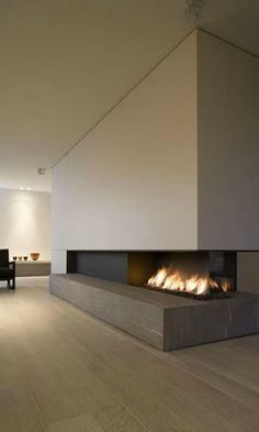 Contemporary home with tv on the top of modern fireplace for Open sided fireplace