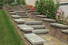 Textured concrete steps and wall caps make a strong statement in this steeply sloped yard. By Cambridge Pavers.