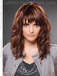Medium curly hairstyle with choppy bangs