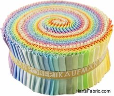 Robert Kaufman Kona Cotton Roll Up Pastel Story. hartsfabric.com | I just watched a YouTube about making quick quilts with jelly roll fabrics.