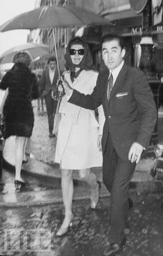 Jacqueline Kennedy Onassis strolls in Paris in 1970. Former first ladies don't need to hold their own umbrellas.