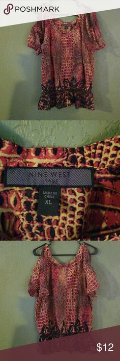 Nine west shirt Nine west shirt in good condition. Has cold shoulder splits with snake skin pattern. Colors are red, Brown and tan. Nine West Tops Button Down Shirts