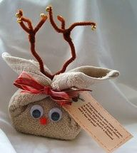 Bath Towel Reindeer stuffed with bath goodies. To make one of these take a bar of soap or two and warp a brown flannel around them diagonally leaving two corners free as ears. Tie with ribbon and then add stick on googly eyes and pipe cleaner antlers.