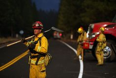 Fire firefighters monitor the Rim Fire along highway