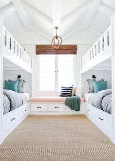 The homeowners wanted a fun retreat to house all their grandkids, and four built-in bunk beds proved the perfect solution. The kids bedroom expertly incorporates the homes beach location into its design, so the space is just as beautiful as it is functional.