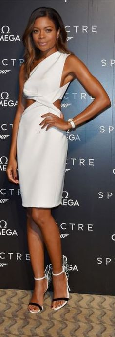 Who made Naomie Harris' white cut out one shoulder dress and black sandals?