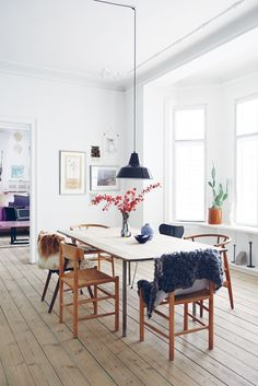 "From The Scandinavian Home: Interiors Inspired by Light. Karen Maj Kornum. Designer: Karen Maj's dining table. ""I would never place eight identical chairs around a table."""