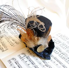 Hey, I found this really awesome Etsy listing at https://www.etsy.com/listing/194374993/steam-punk-mini-top-hat-victorian-tea