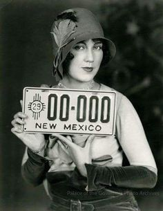 Fay Wray with New Mexico's first license plate, 1929