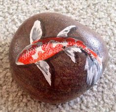 Beautiful koi fish painted on river rocks to look like the fish are swimming right along these smooth stones. Perfect for outdoor garden and pond areas River Rock Landscaping, Landscaping With Rocks, Koi Fish Drawing, Coy Fish, Painted River Rocks, Painted Stones, Pet Rocks, Fish Rocks, Rock Painting Designs