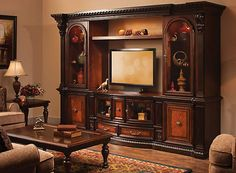 To play up the grandeur of the Grand Estates wall unit, consider a traditional theme to punctuate your space. Complement the furniture's elegant details with old-world lamps, classic artwork and a beautiful floral arrangement. Home Entertainment Centers, Classic Artwork, Interior Exterior, Woodworking Plans, Modern Furniture, The Unit, Wall, House, Floral Arrangement