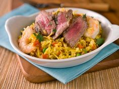 Enjoy a small portion of steak and shrimp in this luxurious healthy dinner of Surf and Turf Paella.