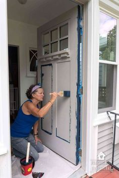 to Paint a Door the Easy Way This is THE easiest way to paint a door! Give your home a makeover with a fresh coat of paint on your front door. Learn how to paint a door the easy way, without even taking it off the hinges!Easy Easy may refer to: Painted Exterior Doors, Painted Front Doors, Black Front Doors, Colored Front Doors, Painted Storm Door, Black Exterior Doors, House Paint Exterior, Exterior House Colors, Front Door Makeover