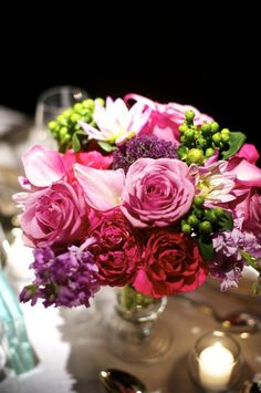 Pink and Purple Arrangement With Green Berries