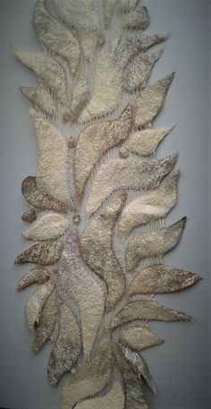 This is a beautiful elegant shawl with a very organic design. It is made of wavy shapes of soft merino wool felt arranged on both sides of tea-dyed cotton scrim. The arrangement of these shapes give a floral, leafy impression. They are made using wool in cream, camel, sienna, pewter and pale Wool Scarf, Felted Scarf, Wedding Shawl, Weaving Patterns, Nuno Felting, Felt Art, Cool Fabric, Felt Flowers, Crafts To Make