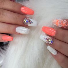 Peach and white nails with rhinestones