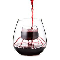 Pour your favorite vintage into the central cell of these stemless goblets, and watch as it cascades into the glass, instantly releasing the wine's full potential of flavors and aromas.