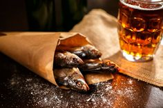dried fish and vintage glass of beer on a black background