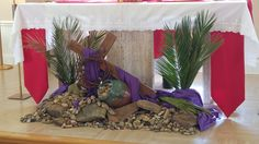 A small area in front of the altar means we have to be extra creative and mindful when decorating. These were our Lenten decorations for Lent Palms frame a large wooden cross draped in purple, lying across rocks. Lent Decorations For Church, Church Crafts, Diy Party Decorations, Alter Flowers, Church Flowers, Alter Decor, Easter Religious, Catholic Altar, Lent 2016