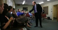 Jim McGovern speaks with a Clark University class about his recent arrest