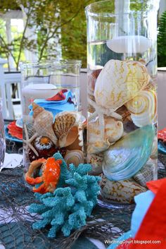 Shell and water filled cylinders for a beachy table centerpiece