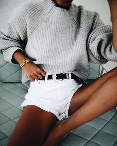 Oversized gray sweater with white shorts.