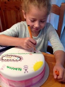 Edible pen cake decoration by child