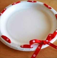 A cheap cookie plate you don't need back! Use a quality paper plate, hole puncher, and some ribbon.