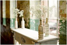music note wrapped bottles with babys breath - so chic!