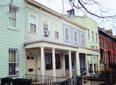 Mint green, periwinkle and pastel yellow, oh my! We love these porches on the two historic wooden houses in Park Slope, Brooklyn. And guess what, the one on the left is owned by our Mayor de Blasio.