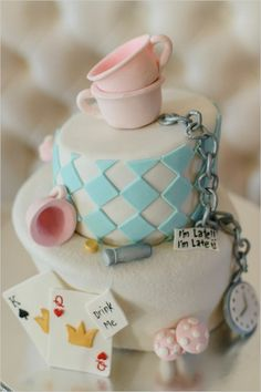 alice in wonderland cake by But Its Not Just Cakes #weddingcake #themedcake #weddingchicks http://www.weddingchicks.com/2014/03/07/winter-in-wonderland-wedding-ideas/