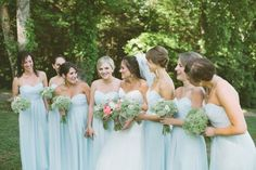 Beautiful pale blue bridesmaid dresses and gypsophila ( baby's breath) bouquets. Simple, yet elegant. ~ E.A