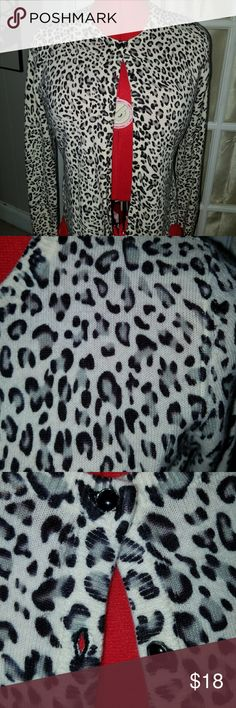 Snow leopard print cardigan Beautiful snow leopard print cardigan with black and silver buttons. EUC,  mint!! designers originals Sweaters Cardigans