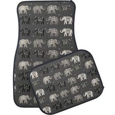 Asian inspired car mats, with graphics of a black, gray, and light gray elephant and polka dot pattern, on a charcoal gray background.