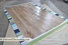 Floor Cloth with fabric glued on vinyl floor. great way to use my fabrics.  solid color fabric can be block printed. but vinyl floor is toxic, so forget it.
