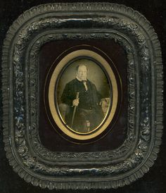 Vintage French daguerreotype of a gentleman with a walking stick, in a Passe Partout mount